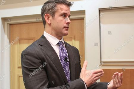 """Rep. Adam Kinzinger R-Ill., speaks to reporters after attending an event, in Chicago. They don't like the talk of impeachment, but there's a small and growing number of Republicans who want the Democratic-run House investigation of President Donald Trump to proceed. 'I want to know what happened,"""" Rep. Adam Kinzinger, said Thursday. But he and some others, including moderates in tight reelection races, say Democrats went too far by starting an impeachment inquiry"""