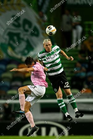 Sporting CP's Jeremy Mathieu (R) in action against LASK Linz's James Holland during their UEFA Europa League Group D soccer match held at Alvalade Stadium, Lisbon, Portugal, 03 October 2019.