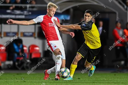 Stock Image of Petr Sevcik from Slavia Prague and Achraf Hakimi from Borussia Dortmund in action during the match