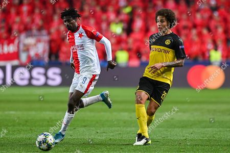 Peter Olayinka from Slavia Prague (L) and Axel Witsel from Borussia Dortmund (R) in action during the match