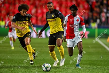 Axel Witsel from Borussia Dortmund (L), Manuel Akanji from Borussia Dortmund (C) and Peter Olayinka from Slavia Prague (R) in action during the match