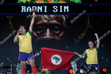 Stock Photo of A picture of the Brazilian indigenous chief Raoni Metuktire is displayed on the big screen during the performance of Brazilian band Francisco, el Hombre, at the Rock in Rio music festival in Rio de Janeiro, Brazil