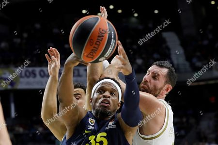 Stock Picture of Real Madrid's Rudy Fernandez (R) in action against Fenerbahce's Ali Muhammed (C) during a Euroleague basketball match between Real Madrid and Fenerbahce at the Wizink Center in Madrid, Spain, 03 October 2019.