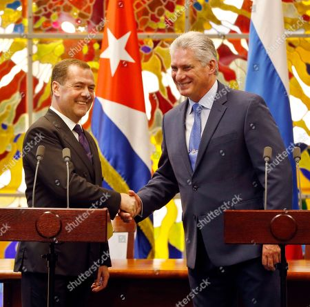 Dmitri Medvedev, Miguel Diaz-Canel. Russian Prime Minister Dmitri Medvedev, left, and Cuban President Miguel Diaz-Canel, shake hands at the Palace of the Revolution in Havana, Cuba . Medvedev arrived Thursday in Cuba, which was long the former Soviet Union's principal ally in Latin America. The visit is seen by some as confirmation of a new closeness at a time when the island is going through a new economic crisis while under new pressure from the United States