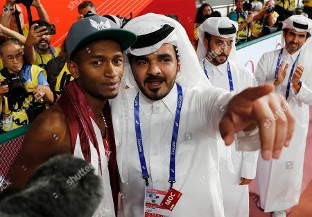 Gold medalist Mutaz Essa Barshim (L) of Qatar and Sheikh Joaan bin Hamad bin Khalifa Al-Thani react after the men's High Jump final during the IAAF World Athletics Championships 2019 at the Khalifa Stadium in Doha, Qatar, 04 October 2019.