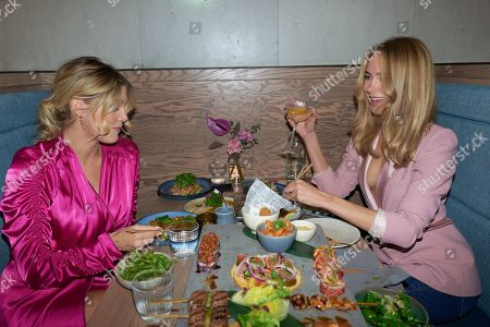 Ashley James and Kimberley Garner attend the opening of YO! Kitchen to celebrate the launch of YO!'s new dining concept and first full-service restaurant