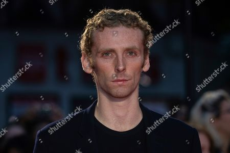 Edward Ashley poses for photographers upon arrival at the premiere of the 'The King' which is screened as part of the London Film Festival, in central London