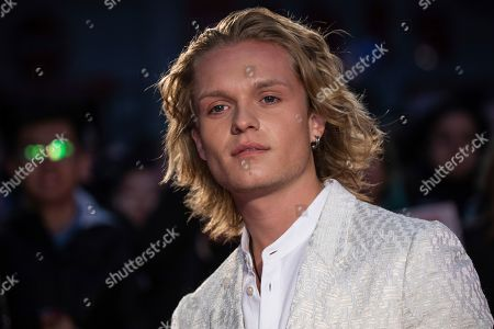Tom Glynn-Carney poses for photographers upon arrival at the premiere of the 'The King' which is screened as part of the London Film Festival, in central London