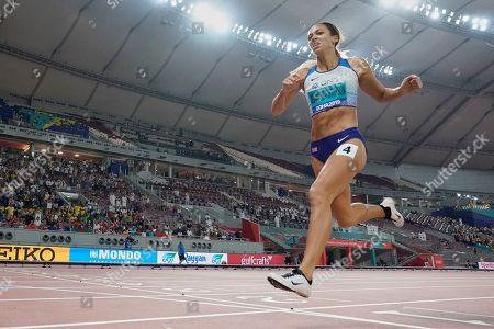 Katarina Johnson-Thompson, of Great Britain, crosses the finish line in the women's 800 to win the heptathlon at the World Athletics Championships in Doha, Qatar