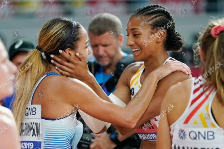 Heptathlon gold medal winner Katarina Johnson-Thompson, left, of Great Britain, is congratulated by silver medalist Nafissatou Thiam, right, of Belgium, at the World Athletics Championships in Doha, Qatar