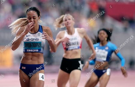 Katarina Johnson-Thompson, of Great Britain, left, reacts after winning the gold medal in the women's heptathlon 800 meter race at the World Athletics Championships in Doha, Qatar