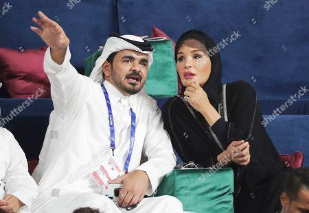 Sheikh Joaan bin Hamad bin Khalifa Al Thani, left, speaks to his mother, Qatar's Sheikha Mozah bint Nasser, right, as they watch the World Athletics Championships in Doha, Qatar