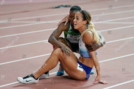 Heptathlon gold medal winner Katarina Johnson-Thompson, right, of Great Britain, is hugged by Odile Ahouanwanou, left, of Benin, following the 800 meter at the World Athletics Championships in Doha, Qatar