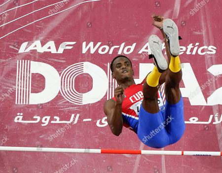 Luis Enrique Zayas, of Cuba, clears the bar during the men's high jump finals at the World Athletics Championships in Doha, Qatar