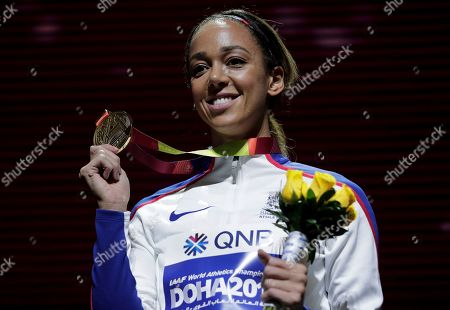 Stock Photo of Katarina Johnson-Thompson of Great Britain shows her gold medal during the medal ceremony for the heptathlon at the World Athletics Championships in Doha, Qatar
