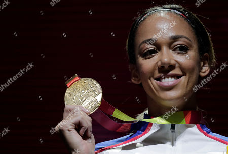 Katarina Johnson-Thompson of Great Britain, poses with her gold medal during the medal ceremony for the heptathlon at the World Athletics Championships in Doha, Qatar
