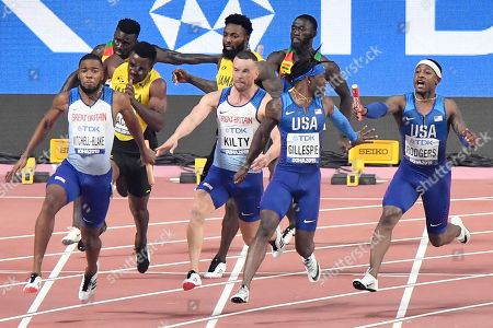Stock Photo of Unites States' Michael Rodgers and Cravon Gillespie, and Great Britain's and Northern Ireland's Richard Kilty and Nethaneel Mitchell-Blake relay during the men's 400 meter relay at the World Athletics Championships in Doha, Qatar