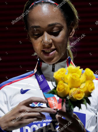 Stock Picture of Katarina Johnson-Thompson of Great Britain, looks her gold medal during the medal ceremony for the heptathlonat the World Athletics Championships in Doha, Qatar