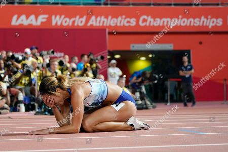 Katarina Johnson-Thompson, of Great Britain, heptathlon gold medalist, reacts after winning the 800 meter and the heptathlon at the World Athletics Championships in Doha, Qatar