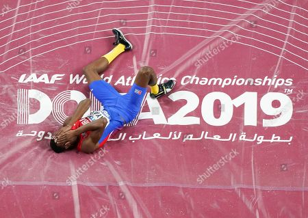 Luis Enrique Zayas, of Cuba, reacts after failing to clear the bar during the men's high jump finals at the World Athletics Championships in Doha, Qatar