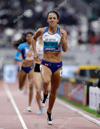 Katarina Johnson-Thompson, of Great Britain, races to the gold medal in the women's heptathlon 800 meter race at the World Athletics Championships in Doha, Qatar