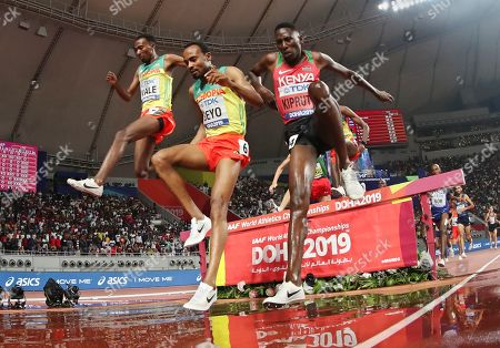 Stock Picture of Conseslus Kipruto, right, of Kenya, winner of the men's 3000 meter steeplechase final, competes with Getnet Wale, left, of Ethiopia and Chala Beyo, center, of Ethiopia, at the World Athletics Championships in Doha, Qatar