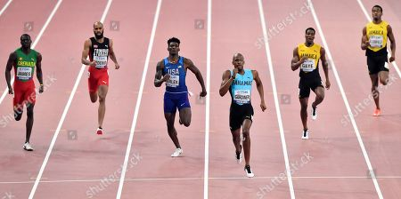 Gold medal and world champion Steven Gardiner, of Bahamas, third from right, and other from left, Kirani James, of Grenada, Machel Cedenio, of Trinidad And Tobago, Fred Kerley, of the United States, ?Demish Gaye, of Jamaica, and Akeem Bloomfield, of Jamaica, compete in the men's 400 meter at the World Athletics Championships in Doha, Qatar