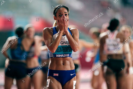 Katarina Johnson-Thompson, of Great Britain, reacts after winning the gold medal in the women's heptathlon 800 meter race at the World Athletics Championships in Doha, Qatar