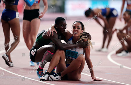 Katarina Johnson-Thompson, of Great Britain, is embraced after winnin the gold medal in the women's heptathlon 800 meter race at the World Athletics Championships in Doha, Qatar