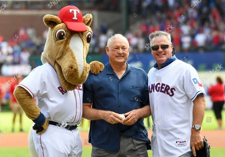 Stock Photo of Texas Rangers mascot Captain, Former Texas Rangers pitchers and President of the club Nolan Ryan (left) and former Rangers pitcher Kenny Rogers pose on the mound before the final Major League Baseball game held at Globe Life Park between the New York Yankees and the Texas Rangers in Arlington, TX Texas defeated New York 6-1 Albert Pena/CSM