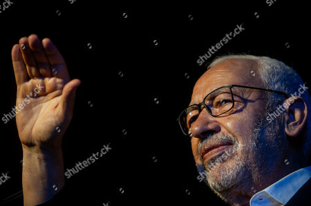 President of the Islamist party Ennahda and candidate for the upcoming Parliamentary election Rached Ghannouchi waves to supporters during a meeting in Tunis, Tunisia, . The parliamentary elections are set for Sunday Oct.6, 2019