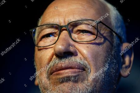 President of the Islamist party Ennahda and candidate for the upcoming Parliamentary election Rached Ghannouchi speaks during a meeting in Tunis, Tunisia, . The parliamentary elections are set for Sunday Oct.6, 2019