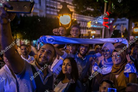 Supporters of Islamist party Ennahda pose for a selfie as they attend a meeting with President of the Islamist party Ennahda and candidate for the upcoming Parliamentary election Rached Ghannouchi in Tunis, Tunisia, . The parliamentary election are set for Sunday Oct.6, 2019