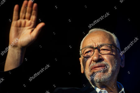 President of the Islamist party Ennahda and candidate for the upcoming Parliamentary election Rached Ghannouchi waves to supporters during a meeting in Tunis, Tunisia, . The parliamentary election are set for Sunday Oct.6, 2019