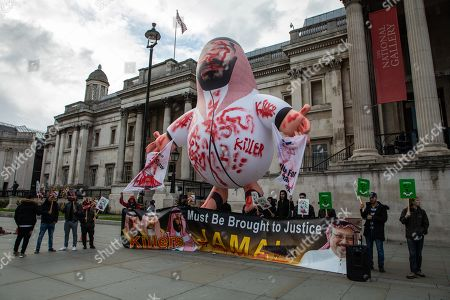 A giant inflatable figure depicting Crown Prince of Saudi Arabia Mohammad bin Salman as a bloodied murderer is displayed in Trafalgar Square by protesters demanding justice for the murder of Washington Post journalist Jamal Khashoggi