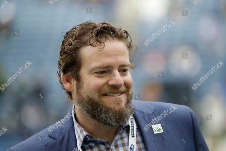 Seattle Seahawks general manager John Schneider walks on the field during warmups before an NFL football game against the Los Angeles Rams, in Seattle