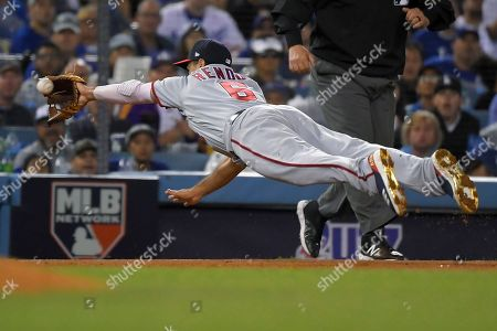 Washington Nationals third baseman Anthony Rendon fields a ball hit by Los Angeles Dodgers' Chris Taylor during the fifth inning of Game 1 in baseball's National League Divisional Series, in Los Angeles. Taylor was safe at first