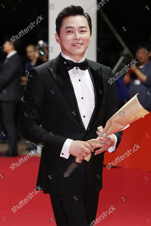 Jo Jung-suk poses for a photo as he arrives for the opening ceremony of the 24th Busan International Film Festival (BIFF) in Busan, South Korea, 03 October 2019. The BIFF will screen 303 films from 85 countries and will runs from 03 to 12 October 2019.