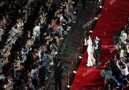 Jung Woo-sung (R) and actress Lee Honey (L) walk on the red carpet during the opening ceremony of the 24th Busan International Film Festival (BIFF) in Busan, South Korea, 03 October 2019. The BIFF will screen 303 films from 85 countries and will runs from 03 to 12 October 2019.