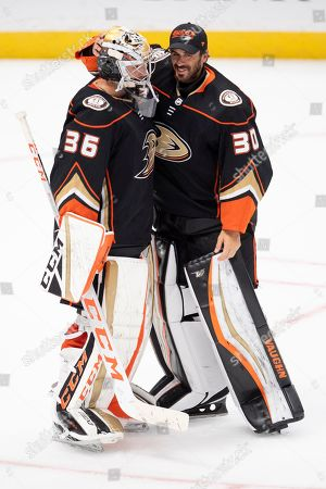 Stock Picture of Anaheim Ducks goaltender John Gibson, left, is being congratulated by goaltender Ryan Miller after defeating Arizona Coyotes 2-1 in an NHL hockey game in Anaheim, Calif