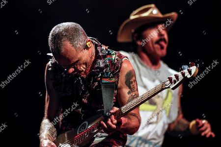 Stock Picture of Bassist Flea (L) and singer Anthony Kiedis (R) of the US band Red Hot Chilli Peppers performs during the Rock in Rio music festival in Rio de Janeiro, Brazil, 03 October 2019.