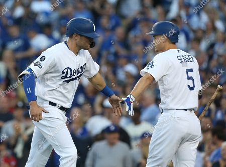 Los Angeles Dodgers center fielder A.J. Pollock (L) is greeted by Los Angeles Dodgers short stop Corey Seager (R) after walking in a score when Washington Nationals starting pitcher Patrick Corbin walked Los Angeles Dodgers Max Muncy with the bases loaded in the first inning of the MLB National League Division Series playoff baseball game one between the Washington Nationals and the Los Angeles Dodgers at Dodgers Stadium in Los Angeles, California, USA, 03 October 2019.