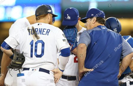 Los Angeles Dodgers pitching coach Rick Honeycutt (2-R) talks with Los Angeles Dodgers starting pitcher Walker Buehler (C) after Buehler loaded the bases, as Los Angeles Dodgers third baseman Justin Turner (2-L), Los Angeles Dodgers shortstop Corey Seager (L), and Los Angeles Dodgers catcher Will Smith (R) listen in during the top of the fourth inning of the MLB National League Division Series playoff baseball game one between the Washington Nationals and the Los Angeles Dodgers at Dodgers Stadium in Los Angeles, California, USA, 03 October 2019.