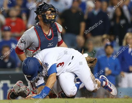 Los Angeles Dodgers left fielder Chris Taylor (R) gets tagged out at home plate by Washington Nationals catcher Yan Gomes (L) of Brazil in the bottom of the fifth inning of the MLB National League Division Series playoff baseball game one between the Washington Nationals and the Los Angeles Dodgers at Dodgers Stadium in Los Angeles, California, USA, 03 October 2019.