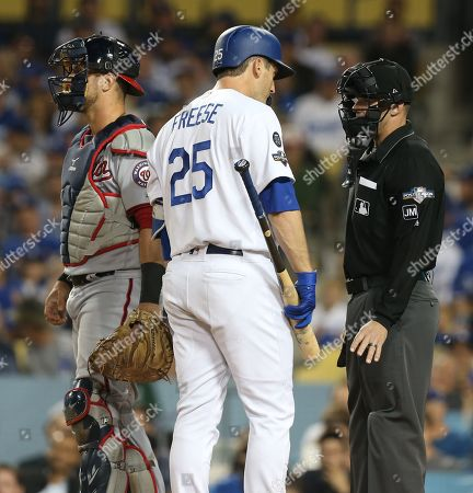 Los Angeles Dodgers first baseman David Freese (C) talks with home plate umpire Will Little (R) after being called out on strikes by Washington Nationals starting pitcher Patrick Corbin as Washington Nationals catcher Yan Gomes (L) of Brazil looks on in the bottom of the fifth inning of the MLB National League Division Series playoff baseball game one between the Washington Nationals and the Los Angeles Dodgers at Dodgers Stadium in Los Angeles, California, USA, 03 October 2019.