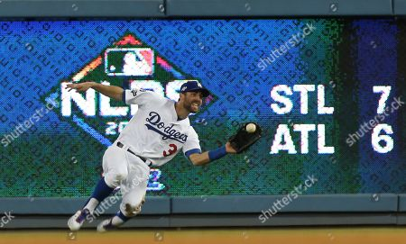 Los Angeles Dodgers right fielder Chris Taylor makes a running catch in the top of the seventh inning of the MLB National League Division Series playoff baseball game one between the Washington Nationals and the Los Angeles Dodgers at Dodgers Stadium in Los Angeles, California, USA, 03 October 2019.