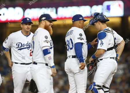 Stock Image of Los Angeles Dodgers manager Dave Roberts (2-R) talks with Los Angeles Dodgers catcher Will Smith (R) as Los Angeles Dodgers third baseman Justin Turner (2-L) and Los Angeles Dodgers first baseman David Freese (L) listen in, in the top of the seventh inning of the MLB National League Division Series playoff baseball game one between the Washington Nationals and the Los Angeles Dodgers at Dodgers Stadium in Los Angeles, California, USA, 03 October 2019.