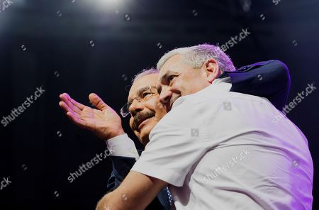 Stock Photo of President of the Dominican Republic Danilo Medina (L), embraces candidate Gonzalo Castillo (R), of the Dominican Liberation Party (PLD), during a campaign event at the Palacio de los Deportes of Santo Domingo, Dominican Republic, 03 October 2019. Dominican President Danilo Medina gave his support to Castillo during the event. The Dominican Republic general election is scheduled to take place 17 May 2020.