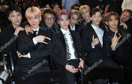 """Lee Soo-man, Ten, Baekhyun,Taeyong, Kai, Taemin, Mark, Lucas. Producer Lee Soo-man, third from left, and members of SuperM, from left, Ten, Baekhyun, Taeyong, Kai, Taemin, Mark and Lucas sit in the audience to watch the premiere of their music video for their song """"Jopping"""" during a media conference, at Capitol Studios in Los Angeles"""