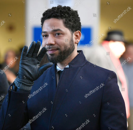 Actor Jussie Smollett smiles and waves to supporters before leaving Cook County Court after his charges were dropped, in Chicago. A Chicago judge is expected to decide whether to let a former U.S. attorney stay on as special prosecutor examining the dismissal of charges against actor Smollett. The hearing, comes after Dan Webb revealed he co-hosted a fundraiser for Kim Foxx during her 2016 run for Chicago's top prosecutor job. Her office in March abruptly dropped charges accusing Smollett of staging a racist, homophobic attack on himself